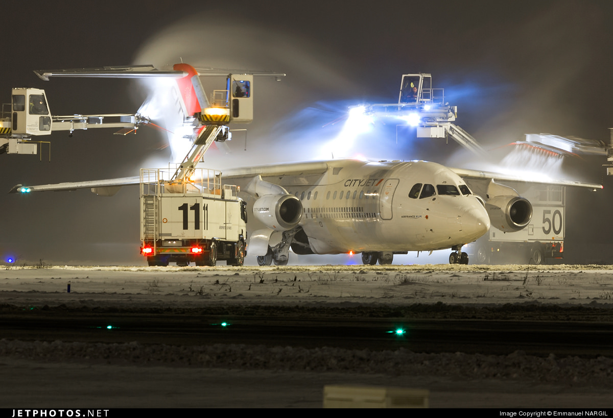 A CityJet Avro RJ85 being deiced.