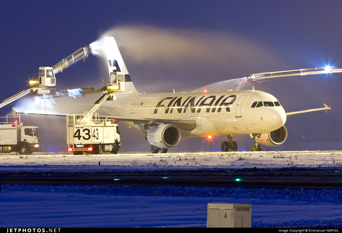 A Finnair A320 being deiced in Paris.