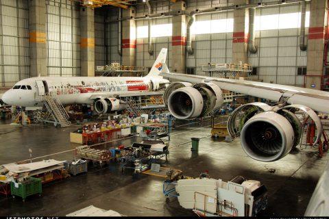 Two airplanes undergo maintenance