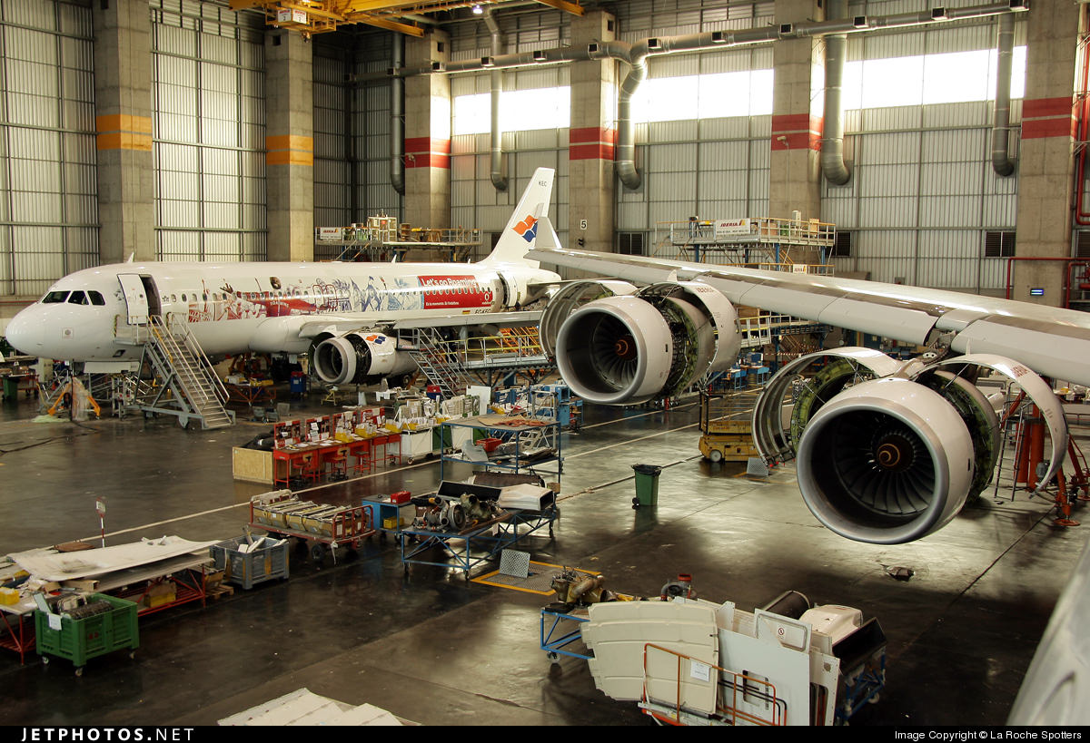 Two airplanes undergo maintenance