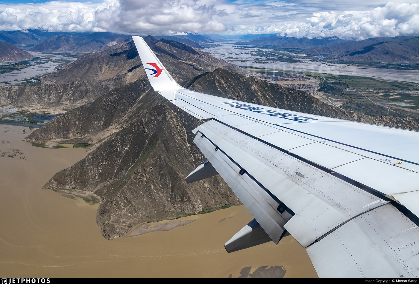 China Eastern Lhasa airport mountains terrain how planes avoid running into things