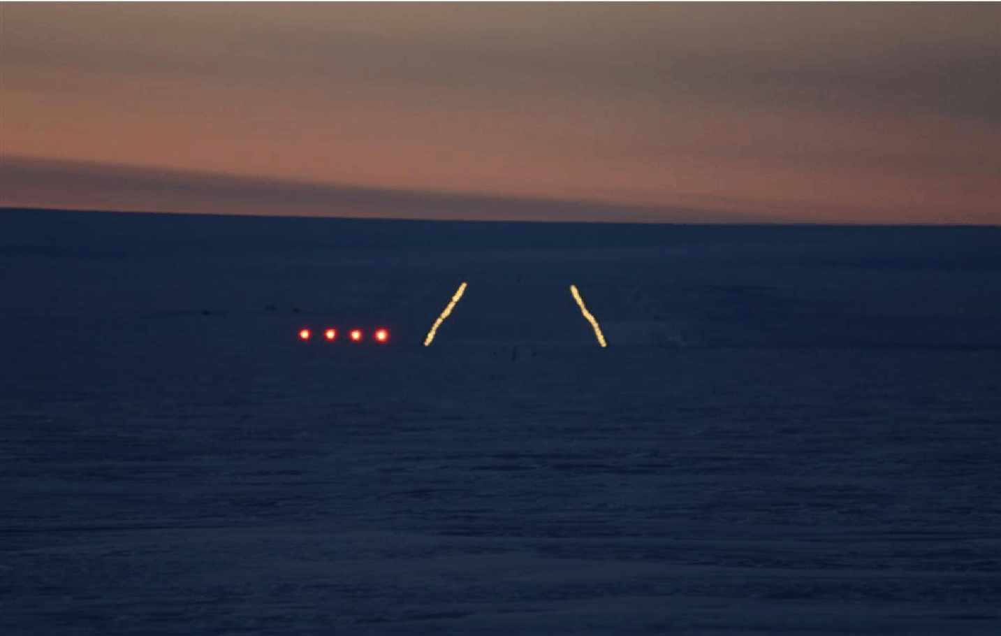 View of the PAPI and runway lighting from the flight deck of an approaching aircraft