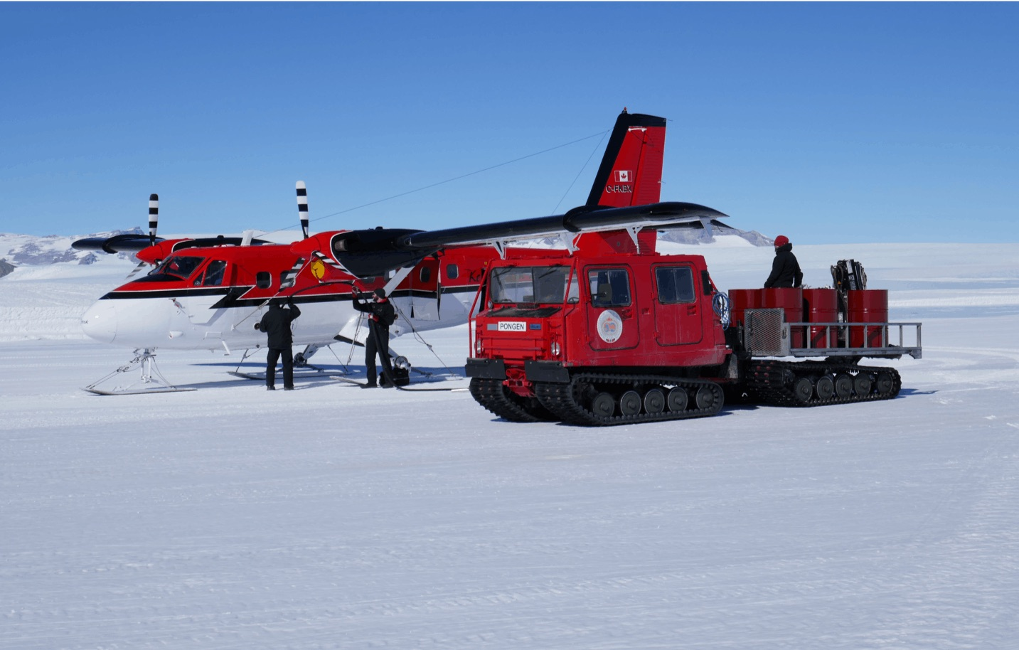 A Canadian Twin Otter is refeuled at Troll Station via 200 liter fuel drums