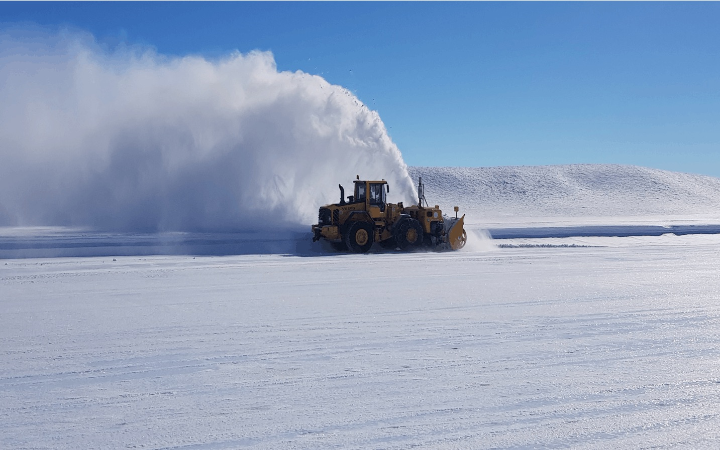 A snow thrower begins preparing the runway at Troll Research Station