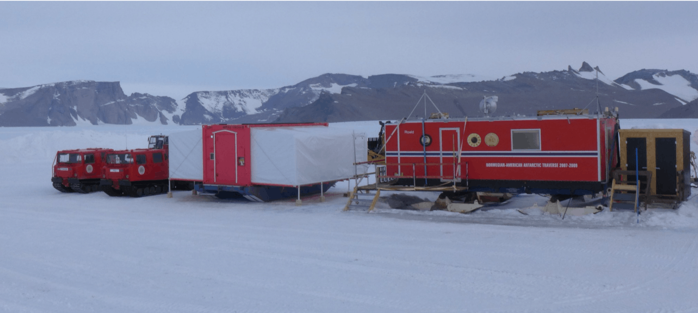 The terminal buildings at Troll Airfield, including the tent for passengers, operations building, and toilets (far right).
